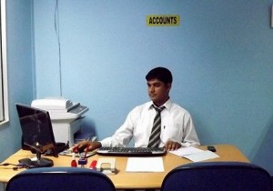 Working at his office desk