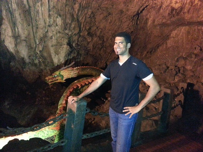 Francis posing with a dragon in chinese underwater cave