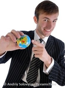 businessman holding a earth globe