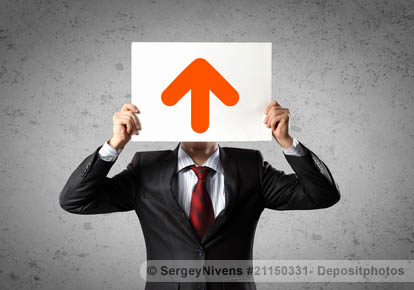 Businessman with an up-arrow signboard