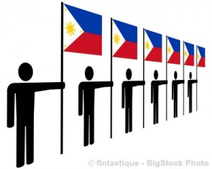 Holding flags of the Philippines in row