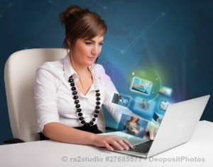 Girl researching pictures on laptop