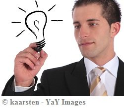 Young guy in a black suite drawing an electric bulb with pen