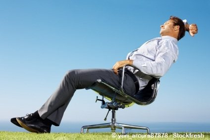 man relaxing outside his office