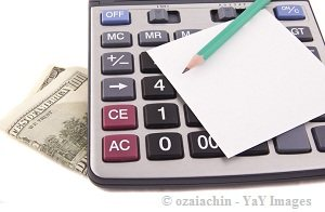 calculator with pencil, paper and currency note