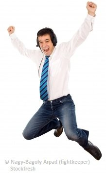 happy man with headphones exclaiming with joy