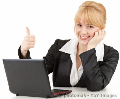 woman working on computer with a thumbs up