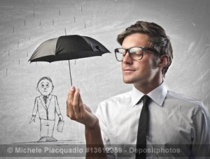 One man protecting another with umbrella