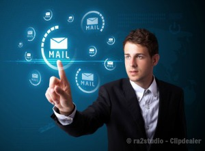 Businessman pressing virtual email icon