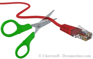 cutting-network-cable-with-scissors