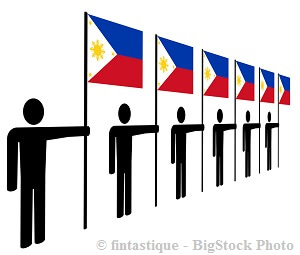 holding the flag of the philippines