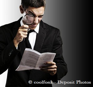 Man in black suit researching something with magnifying glass